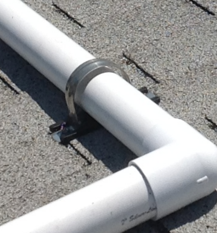 Exclusive Pipe Clamp Base Pads used to raise plumbing off roof