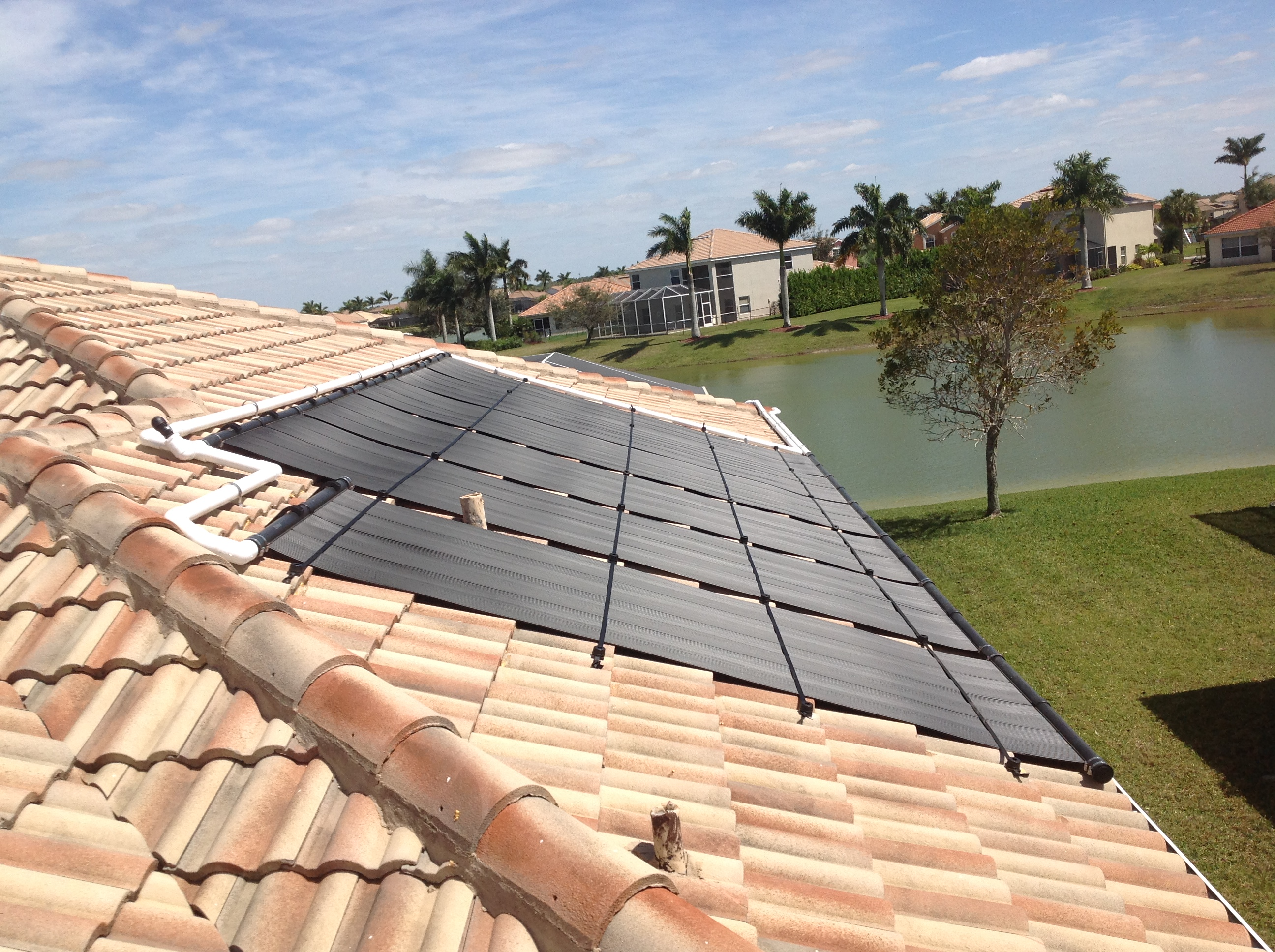 Solar pool heater installed in naples fl florida solar for Pool design naples fl