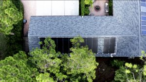 Solar pool heating panels can be installed in partially shaded areas with careful planning. This solar pool heater was installed on a west roof and oversized to account for partial shading throughout the day.