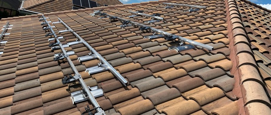 Solar Panels Mounts on a Tile Roof With Quick Mount PV Tile Replacement Mounts