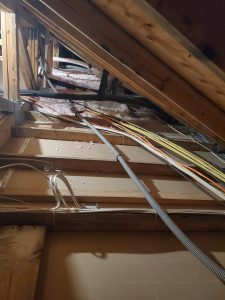 Prewiring through attics can save time, money, and make things look better.